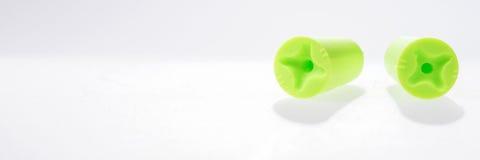 2 зеленых беруш изолированного на белизне Стоковые Изображения