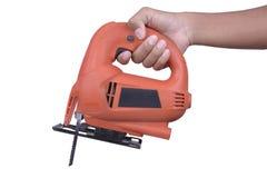 Зигзаг владением руки электрический на белой предпосылке Стоковая Фотография RF