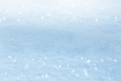 зима белизны снежинок предпосылки голубая Сверкная снег с bokeh Стоковые Фотографии RF