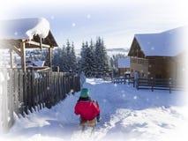 Зима молодой женщины enjoing на ловкости Потеха Wwinter стоковые изображения