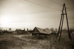 Зима Snowy в русской деревне тонизировано Стоковое фото RF