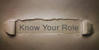 Знайте вашу роль на сорванной бумаге стоковые фото