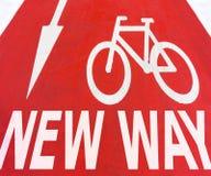 Знаки нового пути белые графические стрелки с велосипедом Стоковое Изображение