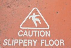 Знаки предупреждая выскальзывание Стоковые Изображения RF