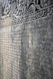 Знаки Sanscrit на камне Стоковые Фото