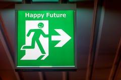 Знак аварийного выхода с будущим желания счастливым Стоковые Изображения RF