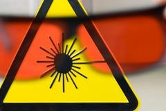 Знак безопасности лазера и glases стоковое изображение rf