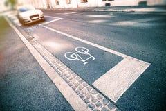 Знак велосипеда на улице Стоковое Изображение