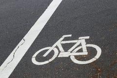 Знак велосипеда на улице Стоковая Фотография