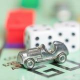 Знак внимания автомобиля на доске игры монополии Стоковое фото RF