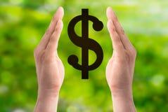 Знак доллара владением рук дальше Стоковое Изображение