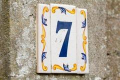 Знак дома 7 на керамической плитке Стоковые Изображения