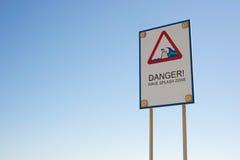 Знак зоны выплеска волны опасности Стоковое Фото