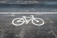 Знак майны велосипеда на дороге асфальта Стоковое Изображение