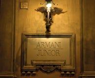 Знак младшего Armani Стоковая Фотография