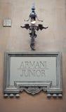 Знак младшего Armani Стоковое фото RF