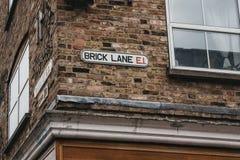 Знак на стене, Лондон имени улицы майны кирпича, Великобритания стоковое фото