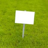 Знак на траве Стоковая Фотография