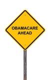 Знак предосторежения ObamaCare вперед - стоковая фотография