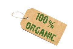 Знак 100 процентов органический бумажный ценник на белизне Стоковые Фотографии RF