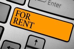 Знак текста показывая для ренты Схематическое фото когда вы сделаете свойство доступный для покупать временно клавиатуру оранжево стоковая фотография rf