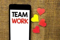 Знак текста показывая работу команды Схематическое фото сотрудничества сотрудничество единства достижения коллективной работы сов стоковое изображение