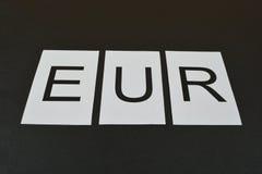 Знак EUR на черной предпосылке Стоковые Фотографии RF