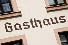 Знак Gasthaus на стене Стоковая Фотография