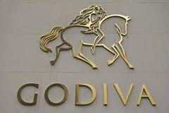 Знак Godiva Chocolatier Компании Стоковое Изображение
