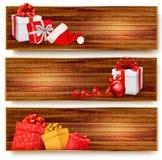 3 знамени рождества с подарочными коробками и santa  иллюстрация штока
