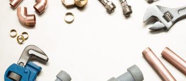 Знамя инструментов водопроводчиков и материалов трубопровода с космосом экземпляра Стоковые Изображения