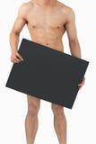 Знамя удерживания мыжского тела Atletic в его руках Стоковое фото RF