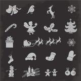 Значки изолированные рождеством на темной предпосылке Стоковое Изображение RF
