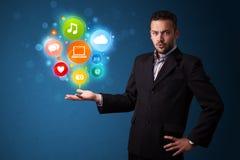 Значки мультимедиа в руке бизнесмена Стоковые Фото