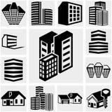 Значок вектора зданий установленный на серый цвет Стоковая Фотография