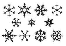Значок вектора черноты снежинки установленный - зима Стоковая Фотография RF
