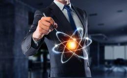 Значок молекулы атома Мультимедиа Стоковое фото RF