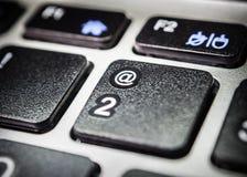 Значок @ на клавиатуре компьютера Стоковые Фотографии RF