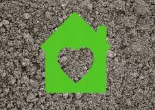 Значок дома на серой земной предпосылке Стоковая Фотография