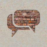 Значок пузыря речи на стене. Стоковое Изображение RF