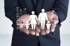 Значок семьи в руках человека Стоковое Изображение