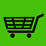 значок черной магазинной тележкаи с зеленой предпосылкой Стоковая Фотография RF