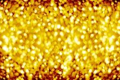 Золотая запачканная сияющая предпосылка bokeh, defocused желтый цвет сверкнает фон, цвет золота сияющие круглые пузыри запачкают  стоковые изображения rf
