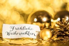 Золотая предпосылка рождества, ярлык с немецким текстом стоковые фотографии rf