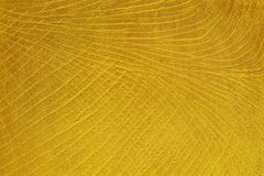 Золотая предпосылка текстуры цемента, золотая стена гипсолита Стоковое Изображение