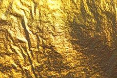 Золотая сияющая предпосылка Яркая золотая предпосылка, sparkles и Стоковые Фотографии RF