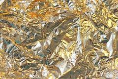 Золотая сияющая предпосылка Яркая золотая предпосылка, sparkles и Стоковая Фотография