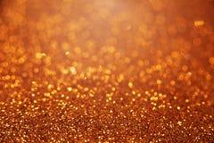 Золотая яркая предпосылка bokeh яркого блеска Стоковая Фотография RF
