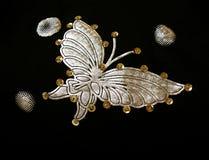 Золотистая бабочка на ткани Стоковая Фотография RF