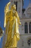 Золотистая статуя ангела Стоковое Изображение